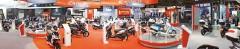 Kymco-Stand auf der EICMA 2011: großzügige Präsentation mit neuer MXU 550i EX als Highlight im ATV-Bereich